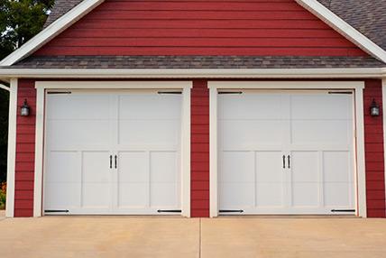 Carriage house bailey garage doors for Garage door wood overlay